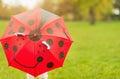 Baby hiding behind red umbrella Royalty Free Stock Photo