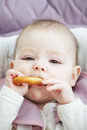 Baby holding bagel closeup photo Stock Images