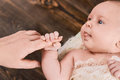 Baby holding finger of woman. Royalty Free Stock Photo