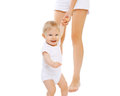 Baby holding hand of mother having fun together Royalty Free Stock Photo