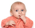 Baby holding his hand in mouth Royalty Free Stock Images