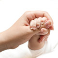 Baby holding mother hand Stock Photo