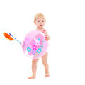 Baby holding pinwheel and beach ball Royalty Free Stock Photo