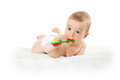 Baby holding a toy Royalty Free Stock Photo