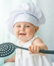 Baby in the hood chef with kitchen tool smiling s hat Royalty Free Stock Photos