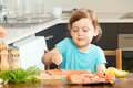 Baby housewife cooking salmon at home kitchen Stock Photos