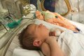 Baby in incubator latin newborn girl sleeping an intensive care unit Stock Photo