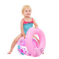 Baby with inflatable ring sitting on ball Royalty Free Stock Photos