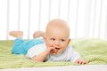 Baby with itching gums little boy finger laying in his grib Stock Images
