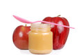 Baby jar with apple sauce and pink spoon Royalty Free Stock Photo