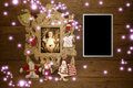 Baby jesus picture and vintage empty photo frame christmas cards on old wooden background with santa ornamets Stock Images