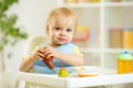 Baby kid child boy eating fruits Royalty Free Stock Photo