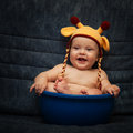 Baby in knitted cap a on a blue background Royalty Free Stock Image