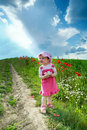 Baby on a lane amongst a field Royalty Free Stock Photo