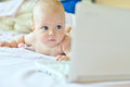 Baby with laptop three months at home Royalty Free Stock Photos
