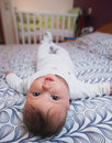 Baby laying on bed Stock Image