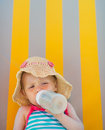 Baby laying on sun bed and drinking from bottle Royalty Free Stock Photography