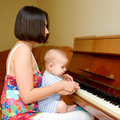 Baby is learning to play Royalty Free Stock Photo