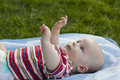 Baby lies on a back cover outdoors Royalty Free Stock Photos