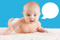 Baby lifting head with speech bubble funny face on its belly its blank Royalty Free Stock Photography