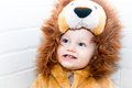 Baby in lion costume wearing a for haloween Stock Photos