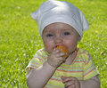 Baby little eats an apricot in the garden Stock Photography