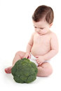 Baby looking at broccoli Royalty Free Stock Photo