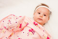 Baby looking cute is out under pink sheet Royalty Free Stock Image