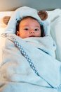 Baby lying wrapped in a towel Royalty Free Stock Photo