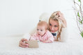 Baby make selfie on mobile phone Royalty Free Stock Photo