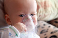 Baby in mask for inhalation Royalty Free Stock Image