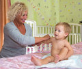 Baby massage at home Royalty Free Stock Photo