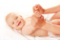 Baby massage. Mother massaging kid hands Royalty Free Stock Photo