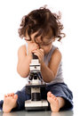 Baby with microscope. Stock Photo
