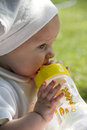Baby milk drinking in the garden Stock Image