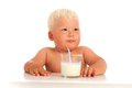 Baby and milk drinks from glass Royalty Free Stock Photography