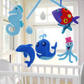 Baby mobile crib in nursery Royalty Free Stock Images