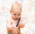 Baby with mobile phone Stock Image