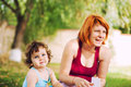 Baby and mom outdoors cute in a park spending time together Royalty Free Stock Image