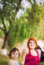 Baby and mom outdoors cute portrait in a park Royalty Free Stock Photos
