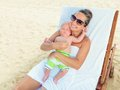 Baby and mom are relaxing on sunbed Stock Images