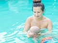 Baby and mom in swimming pool Stock Photo