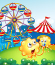 A baby monster with her mother at the hilltop with a carnival illustration of Royalty Free Stock Photo