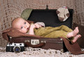 Baby months lies in the retro suitcase Royalty Free Stock Images