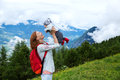 Baby And Mother With The Alps ...