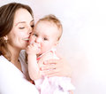 Baby and mother kissing hugging Stock Image