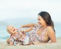 Baby and mother outdoor portrait Royalty Free Stock Image