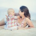 Baby and mother outdoor portrait Royalty Free Stock Photography