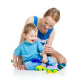 Baby and mother playing together with set toy Stock Photos