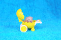 Baby mouse in doll carriage on the blue background Stock Image